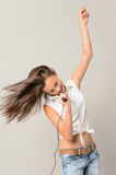 Dancing teenage girl singing with microphone Royalty Free Stock Photos