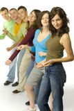 Dancing teenagers. Group of 6 teenagers standing in line. They're looking at camera and dancing Stock Image