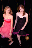 Dancing teens at party. Two pretty teen girls in party dresses dancing Royalty Free Stock Image