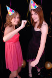 Dancing teens in party hats Stock Images