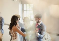 Dancing On Their Wedding Day. Bride and groom are enjoying dancing together on their wedding day stock photo