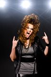 Dancing to the rock music. Ecstatic woman is dancing to the rock music Stock Image