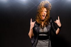 Dancing to the rock music. Ecstatic woman is dancing to the rock music Stock Images