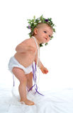 Dancing Toddler. Girl in white diaper cover, with string of pearls, on white background stock images