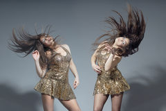 Dancing twins Royalty Free Stock Photo
