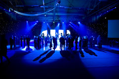 Dancing under blue lights Stock Images
