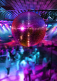 Dancing under disco mirror ball. People dancing under colorful lights of disco mirror ball Royalty Free Stock Image