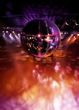 Dancing under disco mirror ball. People dancing in hot disco under colorful lights of mirror ball royalty free stock images