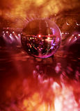 Dancing under disco mirror ball. People dancing in hot disco under colorful lights of mirror ball royalty free stock photo