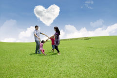 Dancing under love clouds Stock Photos