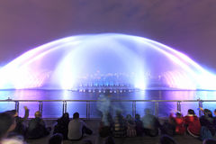 Dancing water fountain in Nanchang at night with thousands of tourists enjoying the scene Stock Photo