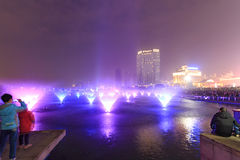 Dancing water fountain in Nanchang at night with thousands of tourists enjoying the scene Royalty Free Stock Image