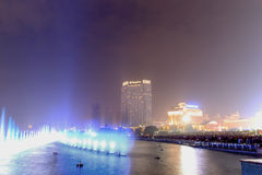 Dancing water fountain in Nanchang at night with thousands of tourists enjoying the scene Stock Images