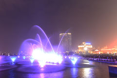 Dancing water fountain in Nanchang at night with thousands of tourists enjoying the scene. Nanchang, China - January 3, 2016: Dancing water fountain in Nanchang Stock Photo