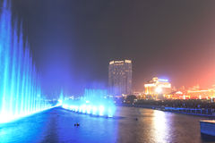 Dancing water fountain in Nanchang at night with thousands of tourists enjoying the scene. Nanchang, China - January 3, 2016: Dancing water fountain in Nanchang Royalty Free Stock Photography