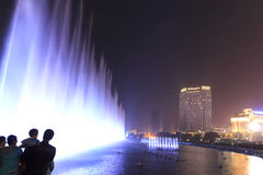 Dancing water fountain in Nanchang at night with thousands of tourists enjoying the scene. Nanchang, China - January 3, 2016: Dancing water fountain in Nanchang Royalty Free Stock Image