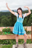 Dancing and waving Knitting bavarian girl in the dirndl Stock Images