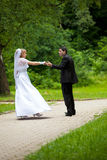 Dancing wedding couple at a park Stock Photo