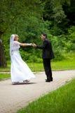 Dancing wedding couple at a park Stock Photo