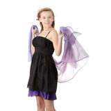 Dancing with wind. Young beautiful blond teen woman in elegant, evening, black dress dancing with wind (hair blowing), isolated on white background Stock Photo