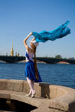 Dancing in the wind. Young woman Dancing in the wind Stock Photo