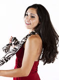 Dancing woman. A half portrait of happy woman dancing and twirling in a red dress Stock Image
