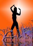 Dancing woman. A silhouette of a dancing woman, floral elements in the foreground Royalty Free Stock Photo