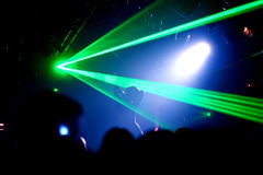 Dancing woman. Between blue scanner/green laser light in a disco stock images