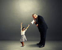 Dancing woman and angry businessman Royalty Free Stock Photography