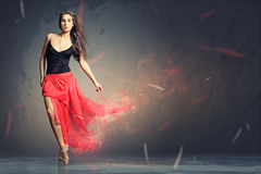 Dancing woman. Beautiful woman dancing on the floor Stock Photography