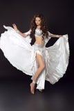 Dancing woman belly dancer, bellydance ballerina, arabian beauty. Female isolated on black studio background Stock Images