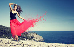 Dancing woman. In front of the ocean Royalty Free Stock Images