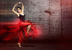 Dancing woman. In front of a wall Stock Photography