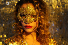 Dancing woman with gold mask Stock Image
