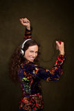 Dancing woman with headphones Stock Photography