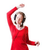 Dancing woman in headphones. Young woman in headphones dancing, isolated on white Stock Photo