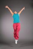 Dancing Woman In Sportswear Jumps Stock Photo