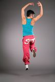 Dancing Woman In Sportswear Jumps From Back Royalty Free Stock Photography