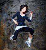 Dancing woman, jumping up. Royalty Free Stock Photo