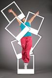 Dancing Woman Jumps With Photo Cards Stock Image