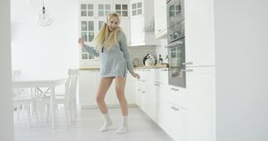 Dancing woman in kitchen stock video footage