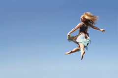 Dancing Woman Leaping through the Air Stock Photo