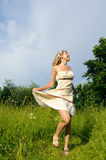 Dancing woman on the meadow Royalty Free Stock Photography