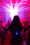Dancing woman in motion. Behind laser/spotlight Stock Photo