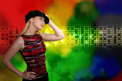 Dancing Woman at Nightclub in Abstract Background. A woman is wearing a black hat and is dancing at an entertainment  nightclub. The background has glowing Royalty Free Stock Images