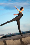 Dancing woman over blue sky. Yoga Royalty Free Stock Images