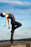 Dancing woman over blue sky. Yoga Royalty Free Stock Photo