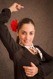 Dancing woman. Portrait of beautiful woman with flower dancing Royalty Free Stock Images
