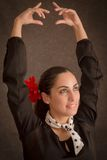Dancing woman. Portrait of beautiful woman with flower dancing Stock Photography