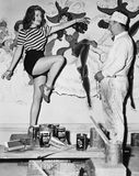 Dancing woman posing for mural painter. (All persons depicted are no longer living and no estate exists. Supplier grants that there will be no model release Stock Images